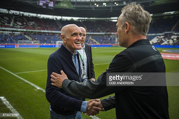Freiburg head coach Christian Streich greets President of Hannover 96 Martin Kind prior to the German first division Bundesliga football match...