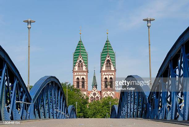 freiburg im breisgau - blue bridge (wiwili-bridge) an the herz-jesukirche in the background - baden wuerttemberg, germany, europe. - baden württemberg stock photos and pictures
