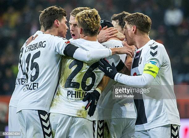 Freiburg players celebrate after scoring the first goal during the Bundesliga match between FC Ingolstadt 04 and SC Freiburg at Audi Sportpark on...