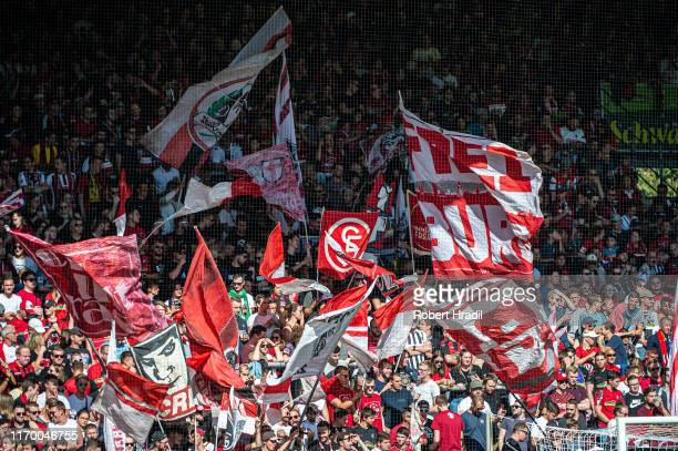 Freiburg supporters cheers during the Bundesliga match between Sport-Club Freiburg and FC Augsburg at Schwarzwald-Stadion on September 21, 2019 in...