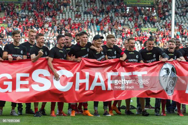 Freiburg team posing with banner for fans during the Bundesliga match between SportClub Freiburg and FC Augsburg at SchwarzwaldStadion on May 12 2018...