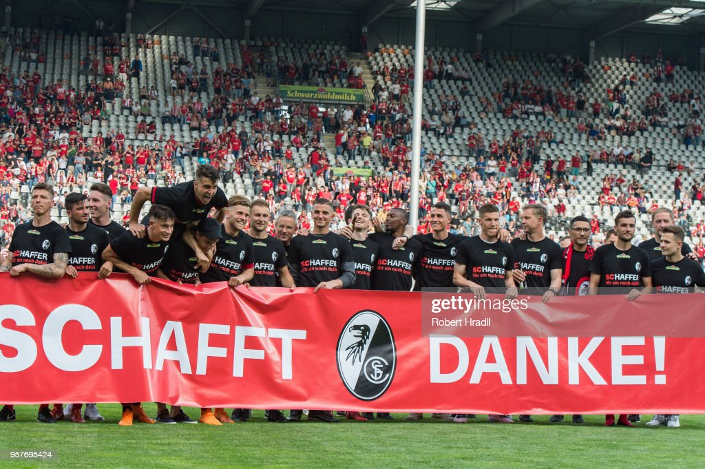 Freiburg team posing with banner for fans during the Bundesliga match between Sport-Club Freiburg and FC Augsburg at Schwarzwald-Stadion on May 12, 2018 in Freiburg im Breisgau, Germany.