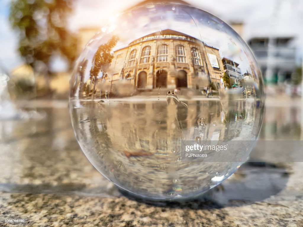 Freiburg Theater watched through a lensball : Foto stock