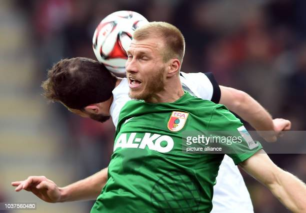 Freiburg's Admir Mehmedi and Augsburg's Ragnar Klavan compete for the ball during the German Bundesliga soccer match between SC Freiburg and FC...