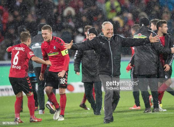 Freiburg's Albanian midfielder Amir Abrashi Freiburg's German forward Nils Petersen and Freiburg's German head coach Christian Streich celebrate...