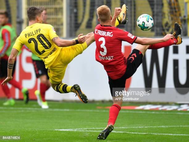Freiburg's Austrian defender Philipp Lienhart and Dortmund's German forward Maximilian Philipp vie for the ball during German first division...