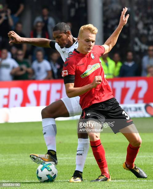 Freiburg's Austrian defender Philipp Lienhart and Frankfurt's French forward Sebastien Haller vie for the ball during the German First division...