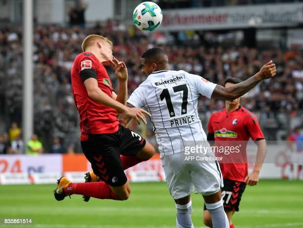 Freiburg's Austrian defender Philipp Lienhart and Frankfurt's Ghanaian midfielder KevinPrince Boateng vie for the ball during the German first...