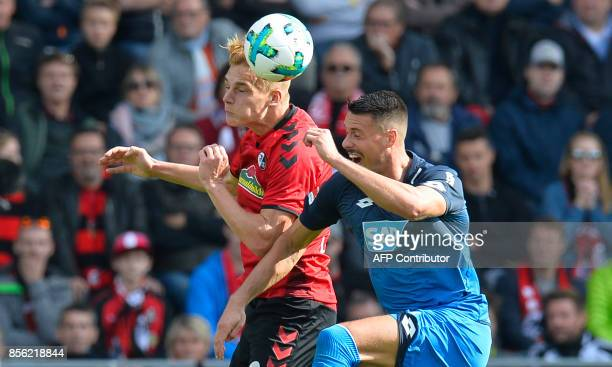 Freiburg's Austrian defender Philipp Lienhart and Hoffenheim's German forward Sandro Wagner vie for the ball during the German first division...