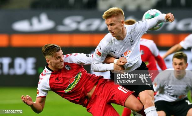 Freiburg's Bosnian forward Ermedin Demirovic and Moenchengladbach's Swedish defender Oscar Wendt vie for the ball during the German first division...
