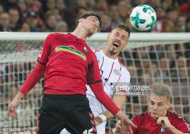 Freiburg's defender Pascal Stenzel and Munich's Sandro Wagner vie with the ball during the German first division Bundesliga football match SC...
