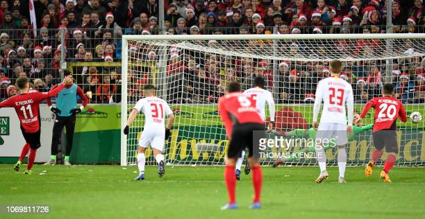 Freiburg's forward Luca Waldschmidt scores the 20 with a penalty past Leipzig's Hungarian goalkeeper Peter Gulacsi R during the German first division...