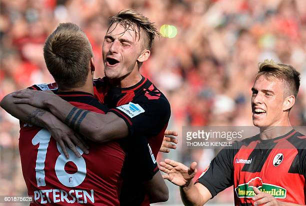 Freiburg's forward Nils Petersen forward Maximilian Philipp and French midfielder CharlesElie Laprévotte celebrate during German first division...