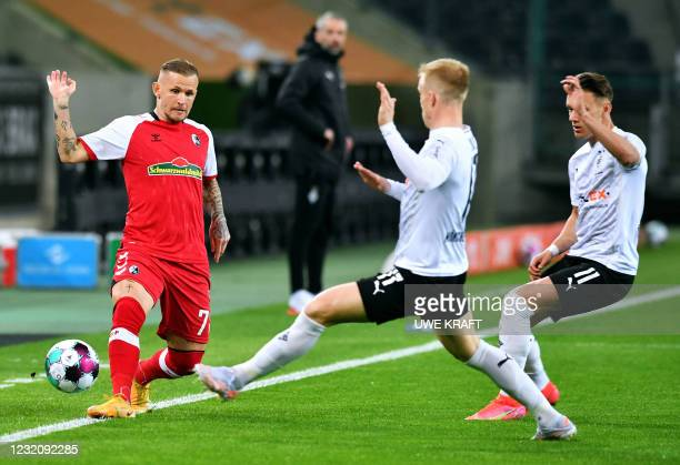 Freiburg's French midfielder Jonathan Schmid and Moenchengladbach's Swedish defender Oscar Wendt vie for the ball during the German first division...