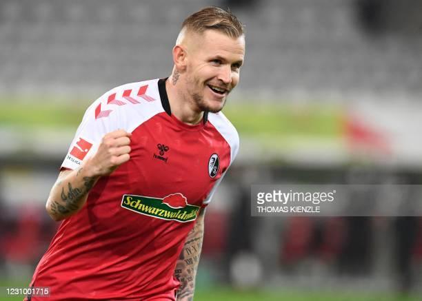 Freiburg's French midfielder Jonathan Schmid celebrates scoring during the German first division Bundesliga football match between SC Freiburg and...