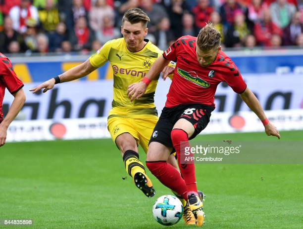 Freiburg's French midfielder Yoric Ravet and Dortmund's German forward Maximilian Philipp vie for the ball during German first division Bundesliga...