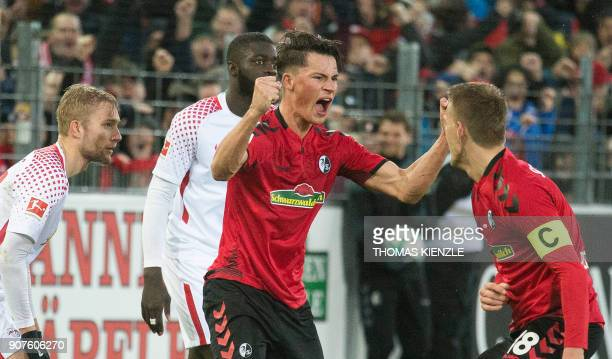 Freiburg's German defender Robin Koch celebrates with Freiburg's German forward Nils Petersen after scoring the 21 during the German first division...