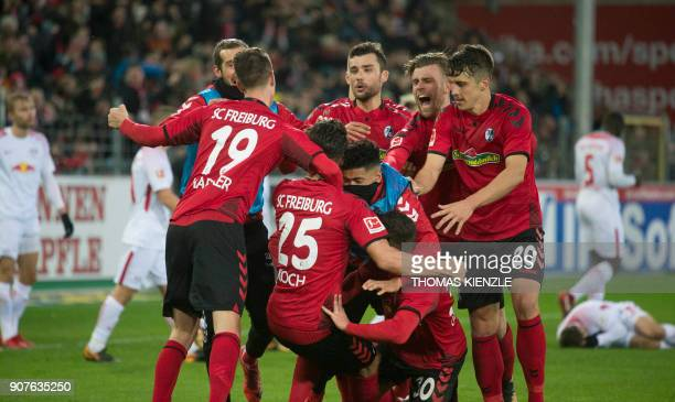 Freiburg's German defender Robin Koch celebrates with teammates after scoring the 21 during the German first division Bundesliga football match SC...