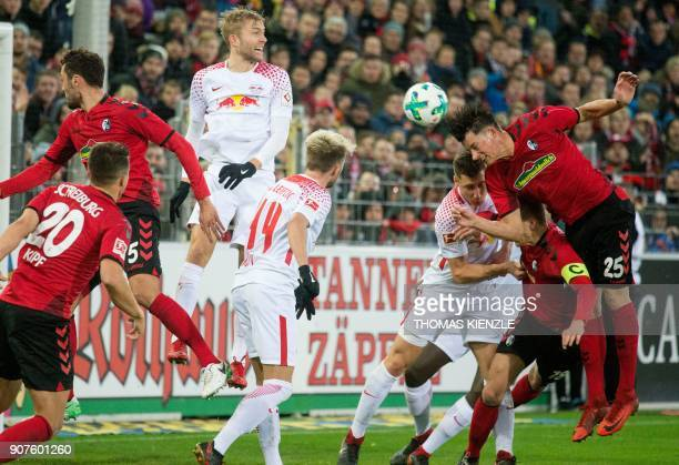 Freiburg's German defender Robin Koch heads the ball to score the 21 during the German first division Bundesliga football match SC Freiburg vs RB...