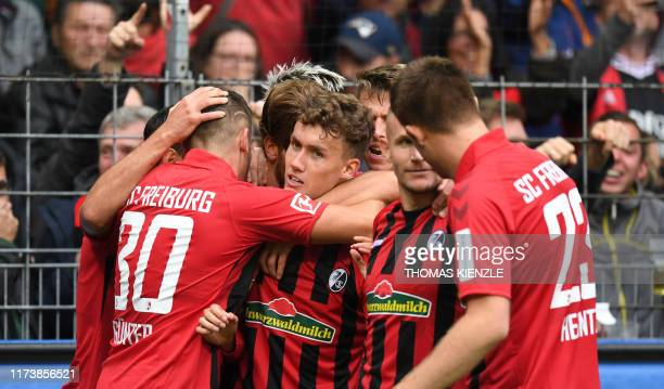 Freiburg's German forward Luca Waldschmidt celebrates with teammates after he scored the 1-1 during the German first division Bundesliga football...