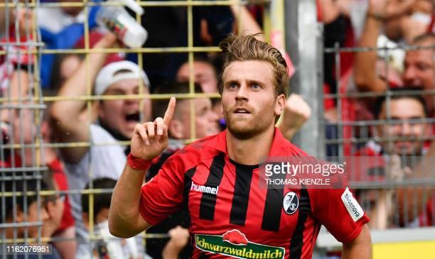Freiburg's German forward Lucas Hoeler celebrates scoring the opening goal during the German first division Bundesliga football match SC Freiburg v...