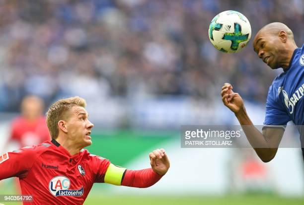 Freiburg's German forward Nils Petersen and Schalke's Brazilian defender Naldo vie for the ball during the German first division Bundesliga football...