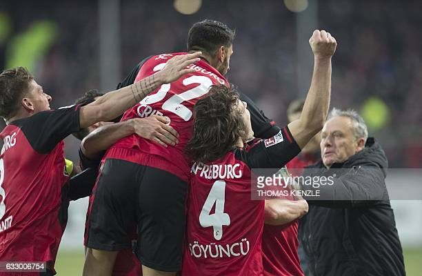 Freiburg's head coach Christian Streich and his players celebrate the team's 2nd goal during the German first division Bundesliga football match...