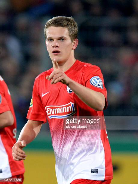 Freiburg's Matthias Ginter celebrates after his 11 goal during the DFB Cup round of sixteen match between SC Freiburg and Bayer 04 Leverkusen in...
