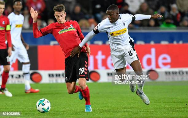 Freiburg's midfielder Janik Haberer and Moenchengladbach's Swiss midfielder Denis Zakaria vie for the ball during the German first division...