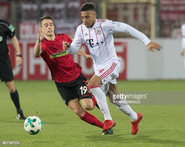 Freiburg's midfielder Janik Haberer and Munich's French midfielder Corentin Tolisso vie with the ball during the German first division Bundesliga...
