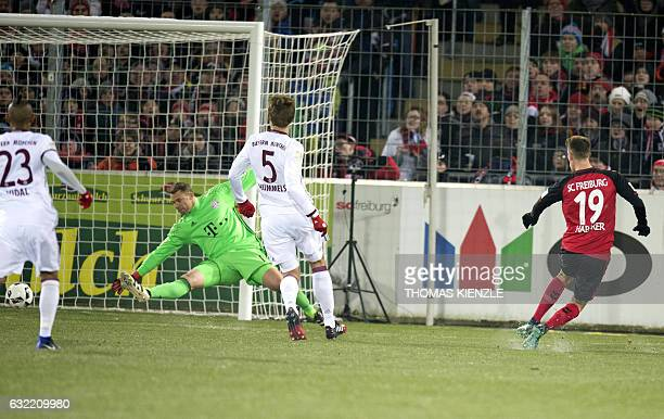 Freiburg's midfielder Janik Haberer scores the opening goal past Munich's goalkeeper Manuel Neuer during the German first division Bundesliga...
