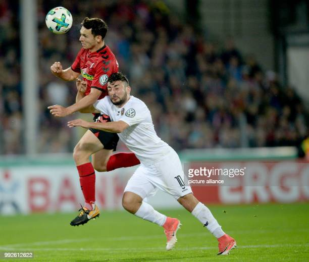 Freiburg's Nicolas Hofler and Dresden's Aias Aosman vying for the ball during the DFBCup soccer match between SC Freiburg and Dynamo Dresden in...