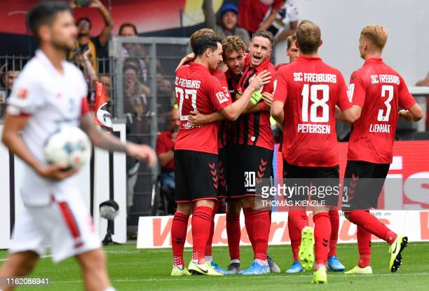 Freiburg's players celebrate after German forward Luca Waldschmidt scored the 30 with a penalty kick during the German first division Bundesliga...