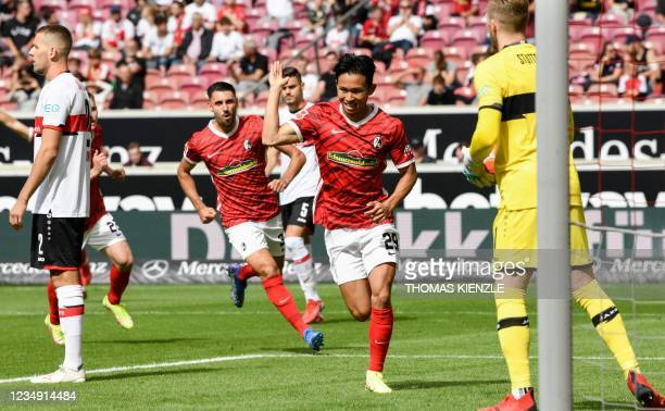 Freiburg's South Korean midfielder Jeong Woo-yeong celebrates scoring the 0-1 during the German first division Bundesliga football match VfB...