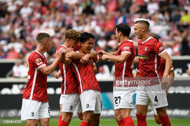 Freiburg's South Korean midfielder Jeong Woo-yeong celebrates scoring the 0-2 during the German first division Bundesliga football match VfB...