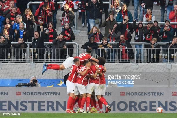 Freiburg's South Korean midfielder Jeong Woo-yeong celebrates scoring with his teammates during the German first division Bundesliga football match...