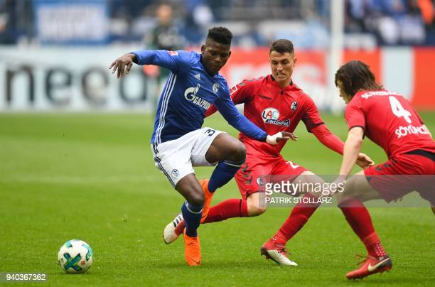 Freiburg's Swiss midfielder Vincent Sierro and Schalke's Swiss forward Breel Embolo vie for the ball during the German first division Bundesliga...
