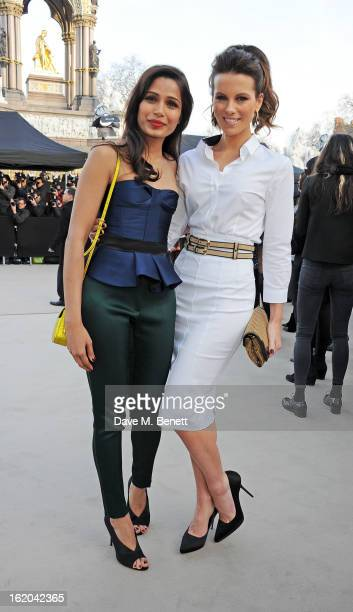 Freida Pinto and Kate Beckinsale arrive at the Burberry Prorsum 2013 Autumn Winter Womenswear Show at Kensington Gardens on February 18 2013 in...