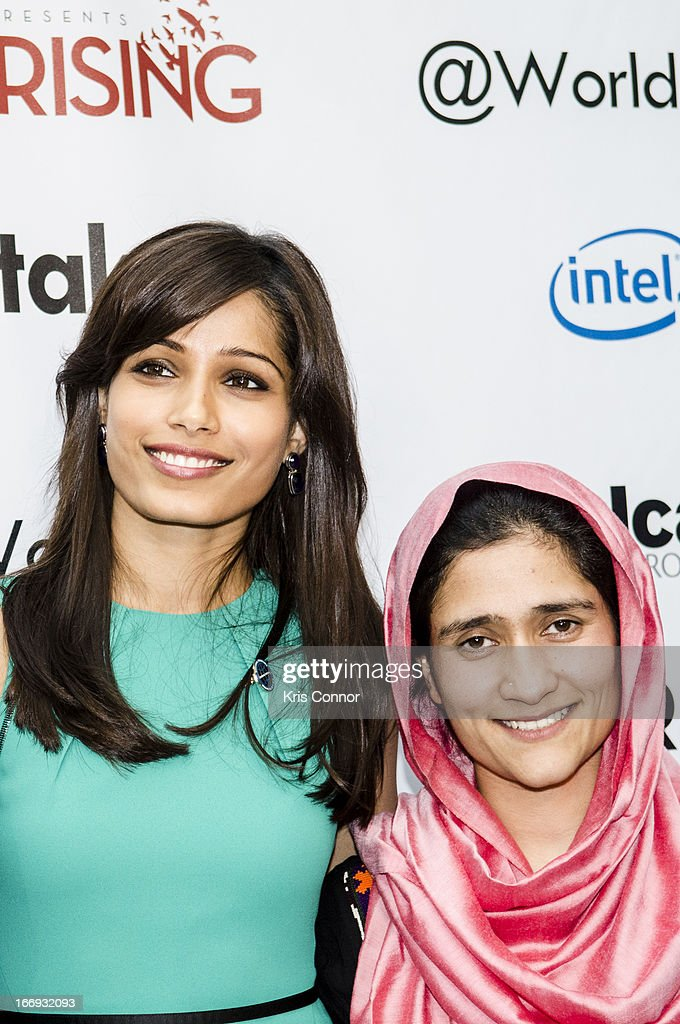 Freida Pinto and Shabana Basij-Rasikh pose for a photo during the Girl Rising: A Rally for Girls and Women screening at The World Bank on April 18, 2013 in Washington, DC.