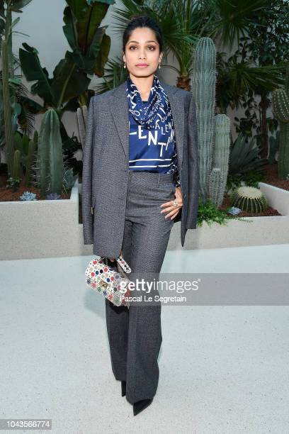 Freida Pinto attends the Valentino show as part of the Paris Fashion Week Womenswear Spring/Summer 2019 on September 30 2018 in Paris France