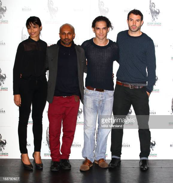 Freida Pinto choreographer Akram Khan Reece Ritchie and Tom Cullen attend a photocall for 'Desert Dancer' at Sadler's Wells Theatre on October 9 2012...