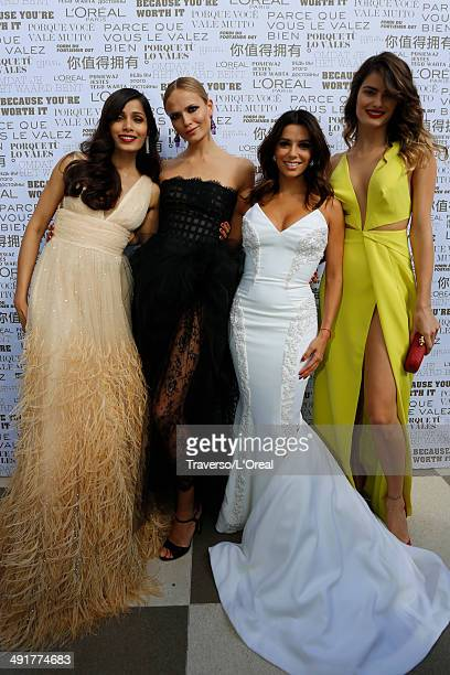 Freida Pinto Natasha Poly Eva Longoria Isabeli Fontana attends the 'Saint Laurent' premiere during the 67th Annual Cannes Film Festival on May 17...