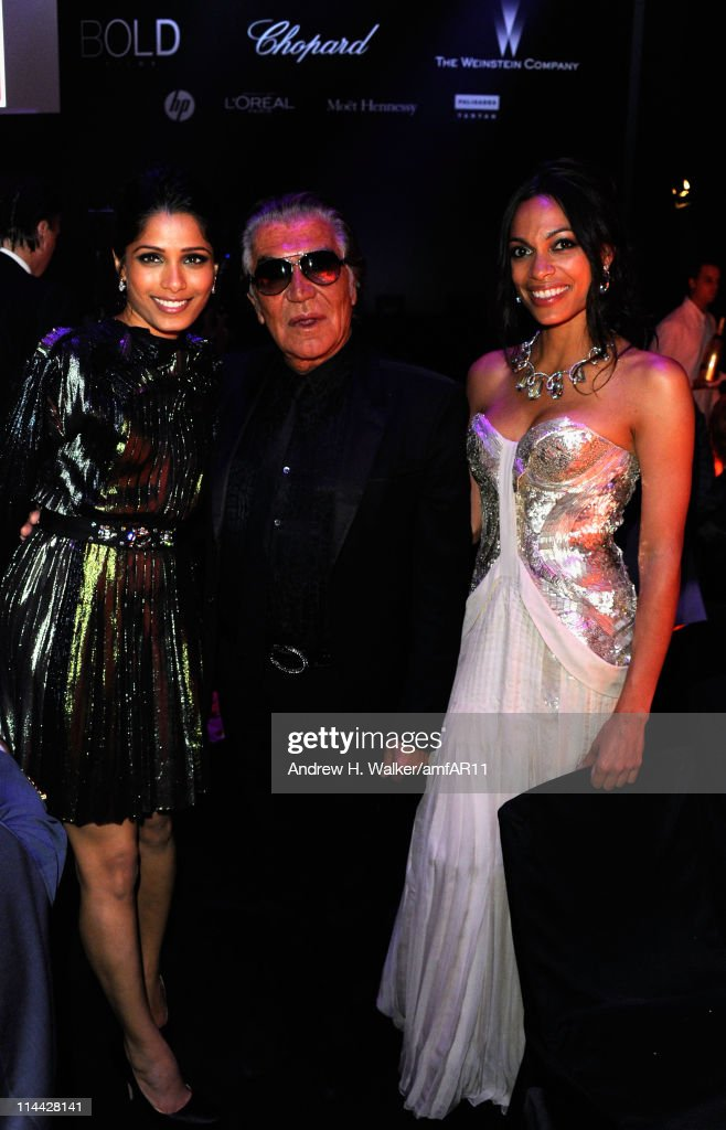 Freida Pinto, Roberto Cavalli and Rosario Dawson attend amfAR's Cinema Against AIDS Gala during the 64th Annual Cannes Film Festival at Hotel Du Cap on May 19, 2011 in Antibes, France.