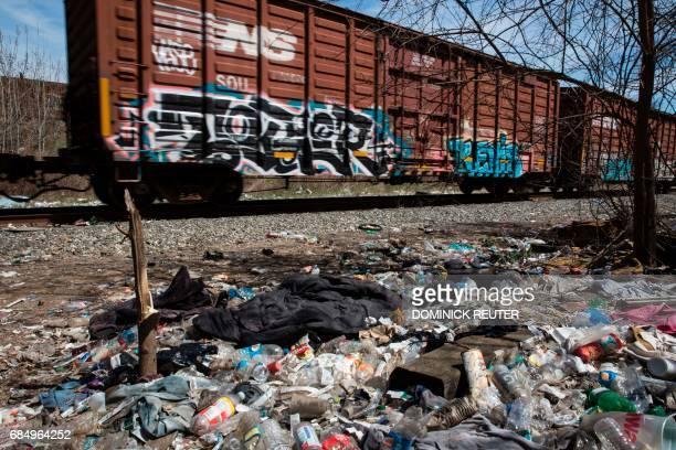 Freight cars rumble past a heroin encampment in the Kensington neighborhood of Philadelphia Pennsylvania on April 10 2017 In North Philadelphia...