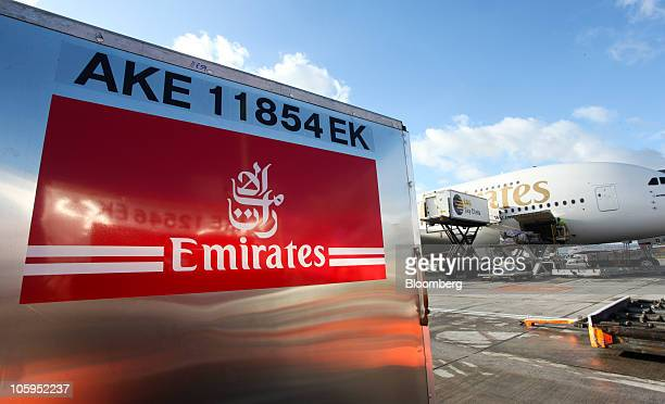 A freight container sits on the tarmac next to an Emirates Airline Airbus A380 airplane at Manchester airport in Manchester UK on Thursday Oct 21...
