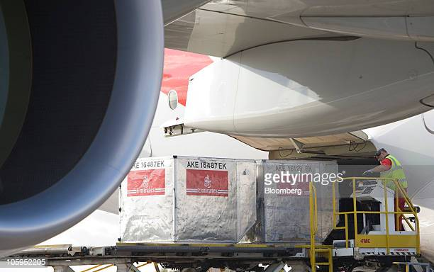 Freight containers are loaded on to an Emirates Airline Airbus A380 airplane at Manchester airport in Manchester UK on Thursday Oct 21 2010 The A380...