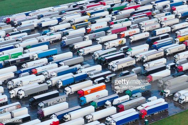 Freight Lorries and heavy goods vehicles are stacked at Manston Airport near Ramsgate, south east England on December 23 where freight transport was...