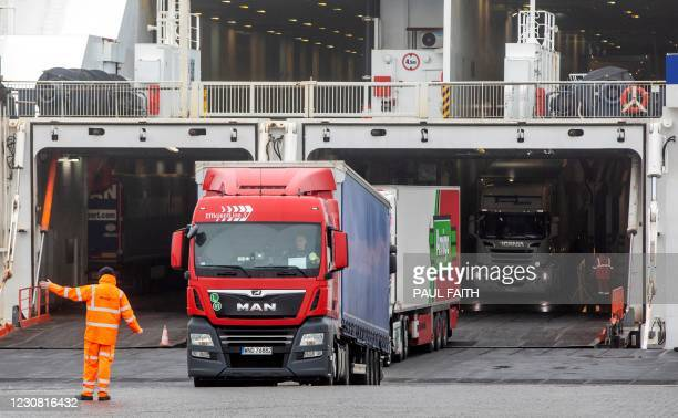 Freight lorries and HGVs disembark from the Stena Line ferry 'Kerry', after arriving at the port of Rosslare Harbour in Rosslare, southeast Ireland...