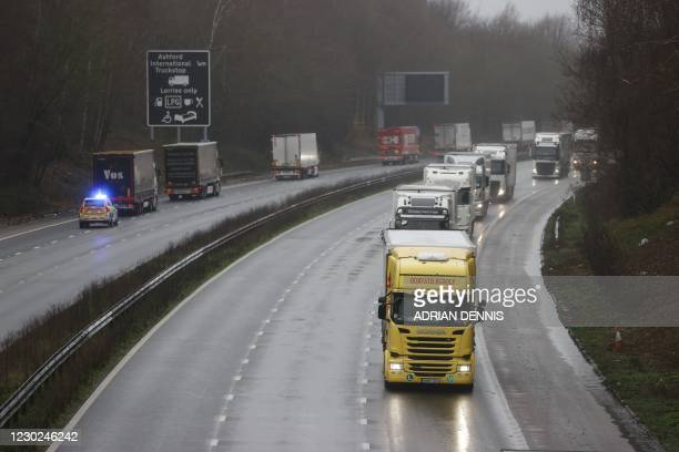 Freight lorries are organised into stacks by police on the M20 motorway which leads to the Port of Dover at Mersham in Kent, south east England on...