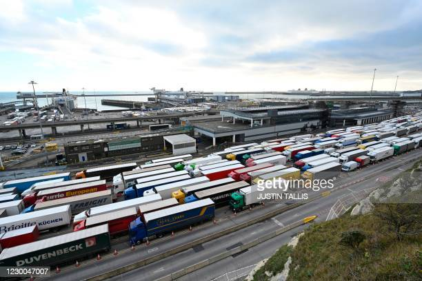 Freight lorries are seen queuing as they enter the port of Dover on the south coast of England on December 10, 2020. - Big queues of lorries snaked...